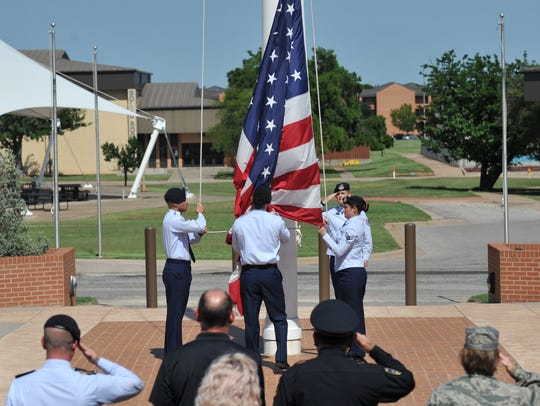 A small crowd saluted and honored the American flag