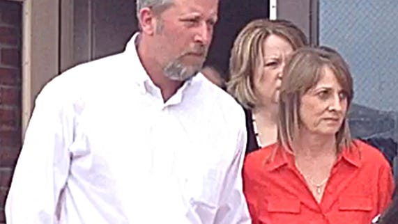 David and Kim Hodgin, of Dickson County, leave the county juvenile courtroom last month. The Hodgins were the foster parents of Sonya.