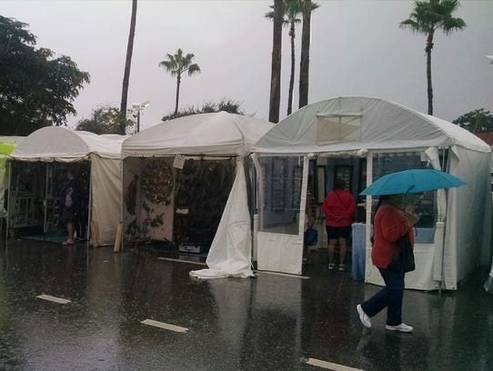 The Cape Coral Art Fair had a wet start to the morning,
