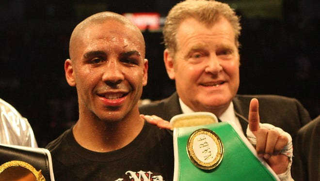 Dan Goossen, right, celebrates after his fighter, Andre Ward, defeated Edison Miranda in 2009.  Goossen died Monday at 64.