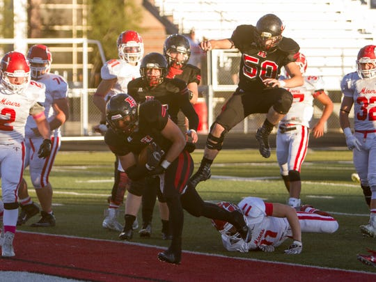 Hurricane defeated Park City, 51-20, in the first round of the 3AA playoffs on Friday. It was the Tigers' second consecutive victory over the Miners at Tiger Stadium.