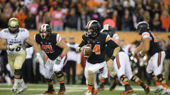 Oct 24, 2015; Corvallis, OR, USA; Oregon State Beavers quarterback Nick Mitchell (14) runs the ball against the Colorado Buffaloes at Reser Stadium. Mandatory Credit: Scott Olmos-USA TODAY Sports