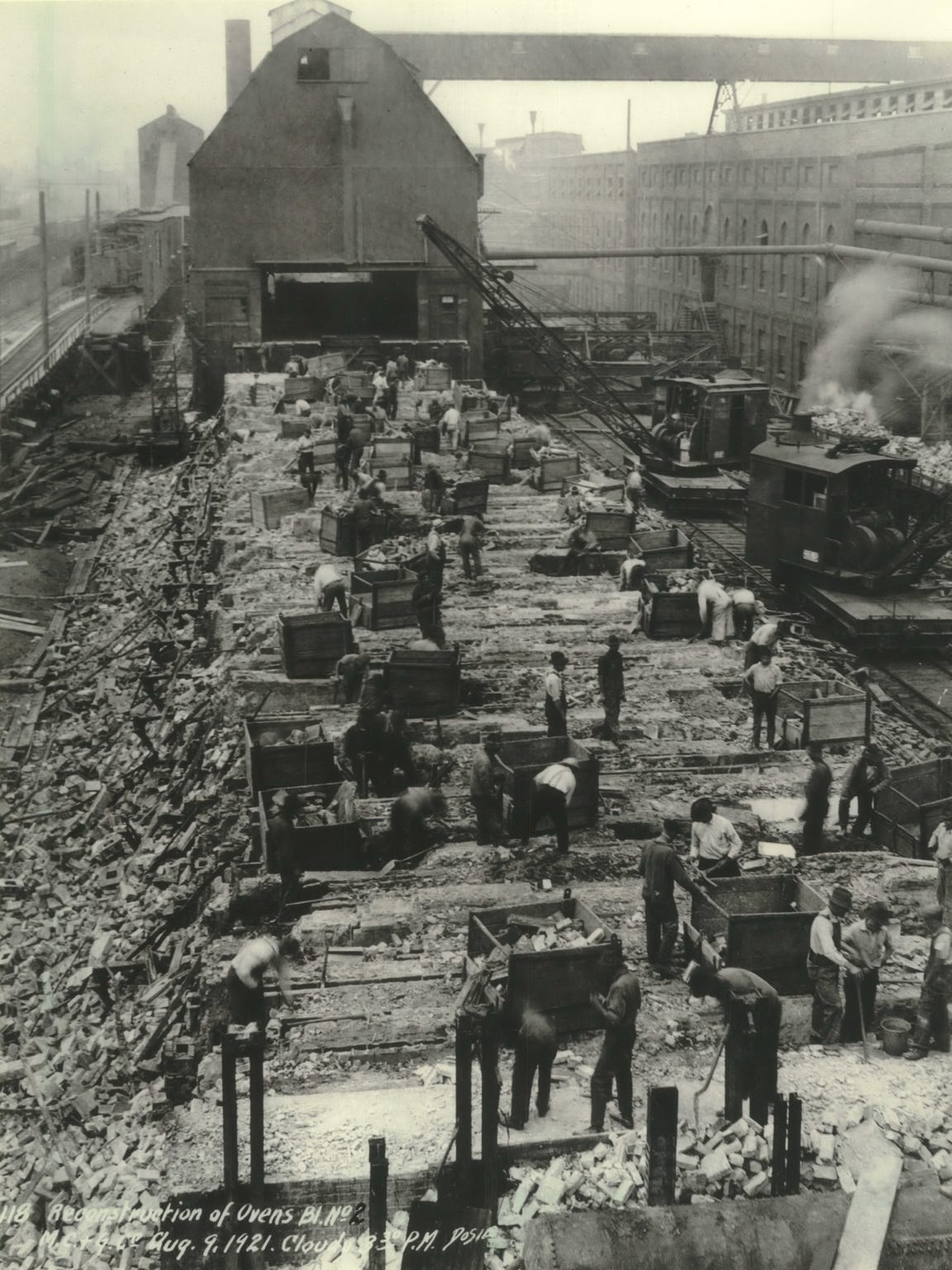 This 1921 photo shows workers as they rebuilt coke