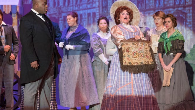 """Sheryl Vandenberg portraying Dolly sings during a dress rehearsal of """"Hello Dolly"""" at Pensacola State College's Ashmore Auditorium. The show was one of the area's most impactful in 2016."""