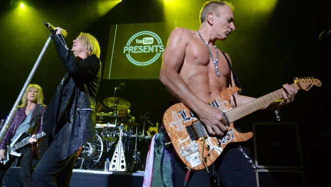 Def Leppard's Rick Savage, Joe Elliott and Phil Collen  perform at YouTube Presents Def Leppard At The House Of Blues at House of Blues Sunset Strip on June 6, 2012 in West Hollywood, California.