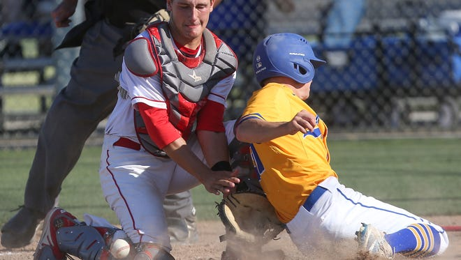 Palm Desert catcher Anthony Boetto is unable to make the play as a La Mirada baserunner scores in the CIF SS baseball playoffs in Palm Desert, May 23, 2017.