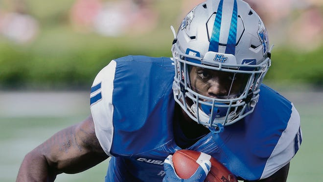 MTSU running back I'Tavius Mathers (4) became the first player to rush for 100 yards and record 100 receiving yards.