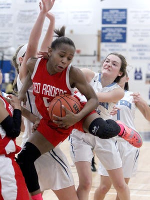 North Rockland's Gabrielle Cajou is pressured by Suffern's Brianna Witt during their game at Suffern Feb. 4, 2015. North Rockland won 46-38.