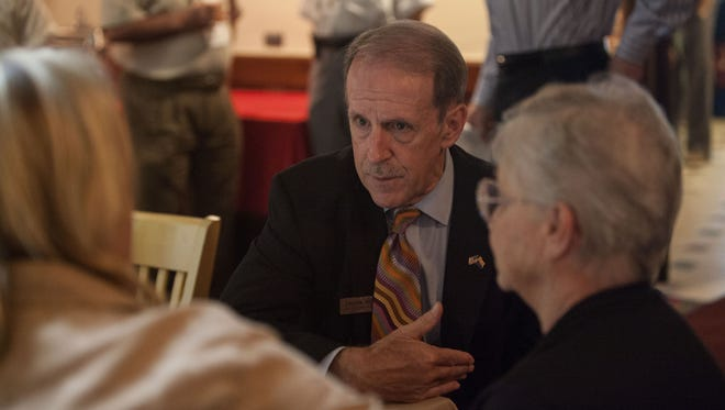 Frank Riggs speaks with members of a physicians group at a recent gathering.  Karla Towle/The Republic Frank Riggs, gubernatorial candidate, spoke at the Association of Physicians and Surgeons dinner at Macayo Mexican Restaurant on July 2.