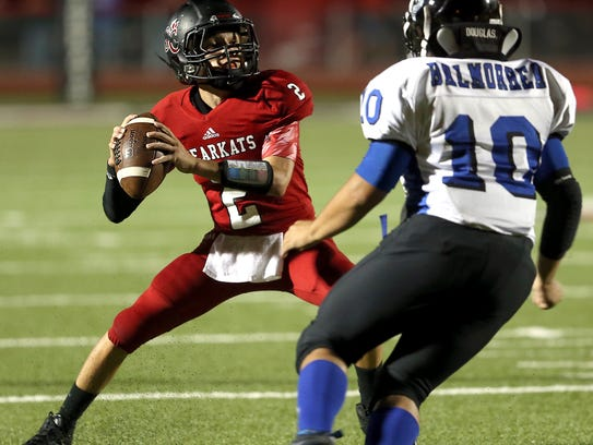 Garden City's Trent McMillan threw five touchdown passes