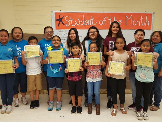 The Guahan Academy Charter School honored its September Student of the Month awardees on Oct. 12. Pictured from left (front row): Ysabella Rivera; Christian Topasna;Ciana'lyn Sablan-Cruz; Jimmy Manibusan; Ahlleiya Sudo; Anica Kom and Ronia Billuk. Pictured from left (back row): Teresita Cruz, Dean of High School Guahan Academy Charter School; Connie Maratita; Justine Rodriguez; Lara Reyes; Ritacia Fegurgur; Joy Guiking and Jennie Lyn Barroga and Dean of Elementary School Guahan Academy Charter School.