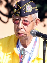 Korean War veterans Ruben Acosta reminded the Veterans Day audience of the importance of honoring and keeping all veterans of the armed forces in their thoughts.