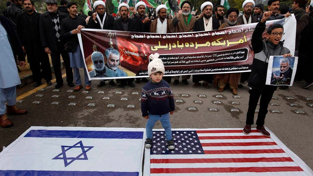 "Shiite Muslims children stand on representations of Israeli and U.S. flags during a rally to condemn the killing of Iranian Revolutionary Guard Gen. Qassem Soleimani by a U.S. airstrike in Iraq, in Islamabad, Pakistan, Sunday. Iran has vowed ""harsh retaliation"" for the U.S. airstrike near Baghdad's airport that killed Tehran's top general and the architect of its interventions across the Middle East, as tensions soared in the wake of the targeted killing."