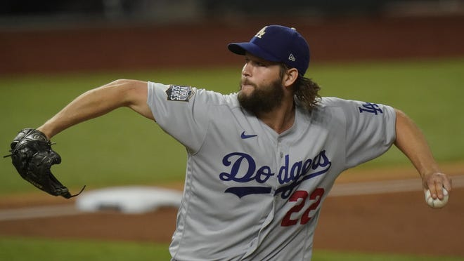 Los Angeles Dodgers starting pitcher Clayton Kershaw throws against the Tampa Bay Rays during the first inning in Game 5 of the World Series on Sunday, in Arlington, Texas.