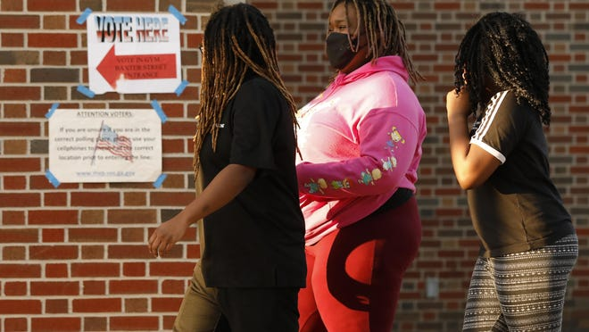Voters head to cast ballots Tuesday at Clarke Central High School in Athens.