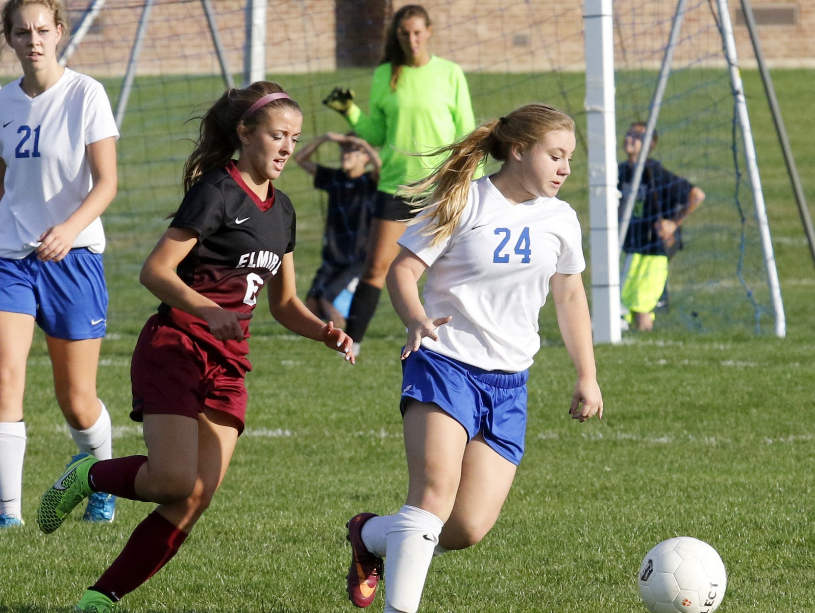 Jade Munson of Horseheads dribbles the ball in front of Elmira's Abby Seymour during a 1-1 girls soccer tie Thursday at Horseheads.