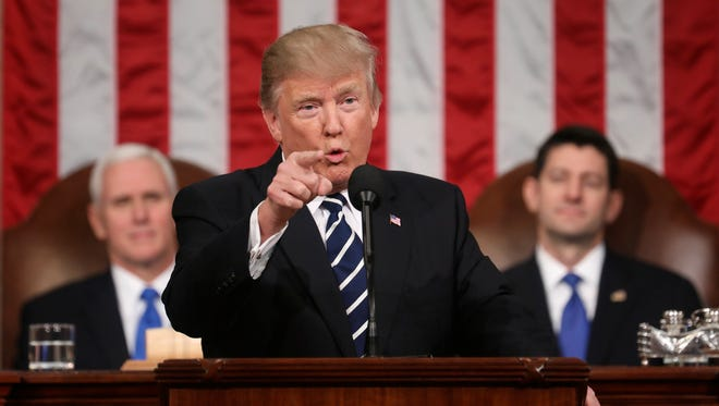 In this Feb. 28, 2017, file photo, President Trump addresses a joint session of Congress as Vice President Mike Pence and House Speaker Paul Ryan listen.