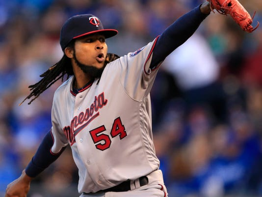 Minnesota Twins starting pitcher Ervin Santana delivers to a Kansas City Royals batter during the first inning of a baseball game at Kauffman Stadium in Kansas City, Mo., Friday, April 8, 2016. (AP Photo/Orlin Wagner)
