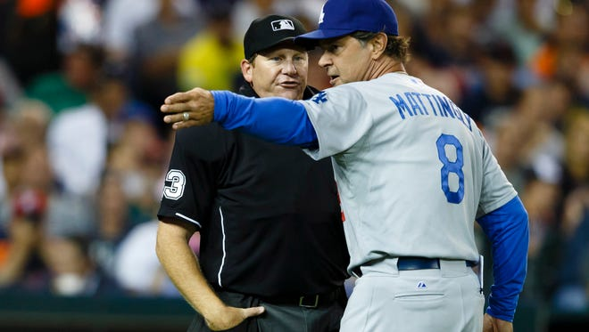 Los Angeles Dodgers manager Don Mattingly argues with umpire Paul Schrieber in the sixth inning against the Detroit Tigers at Comerica Park.