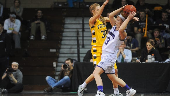 Winona State's Alexis Foley (13) tries to keep the
