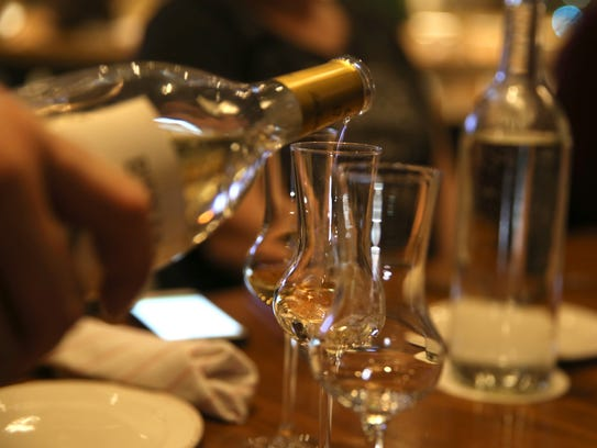 Grappa is poured at Grappa in College Town in Rochester.