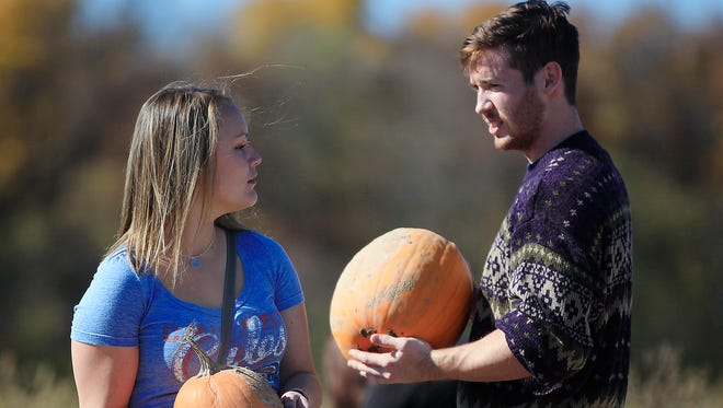 Brandon Phillips picks pumpkins with Claire Huntley at the Landess Family Farm for a dating experiment being held by a Ball State leadership class. The experiment focuses on three couples that go on a series of structured dates and analyzes the progress.