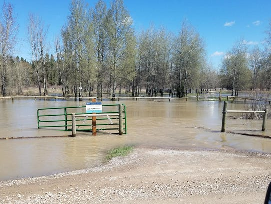 Floodwater surrounds a property in Lincoln