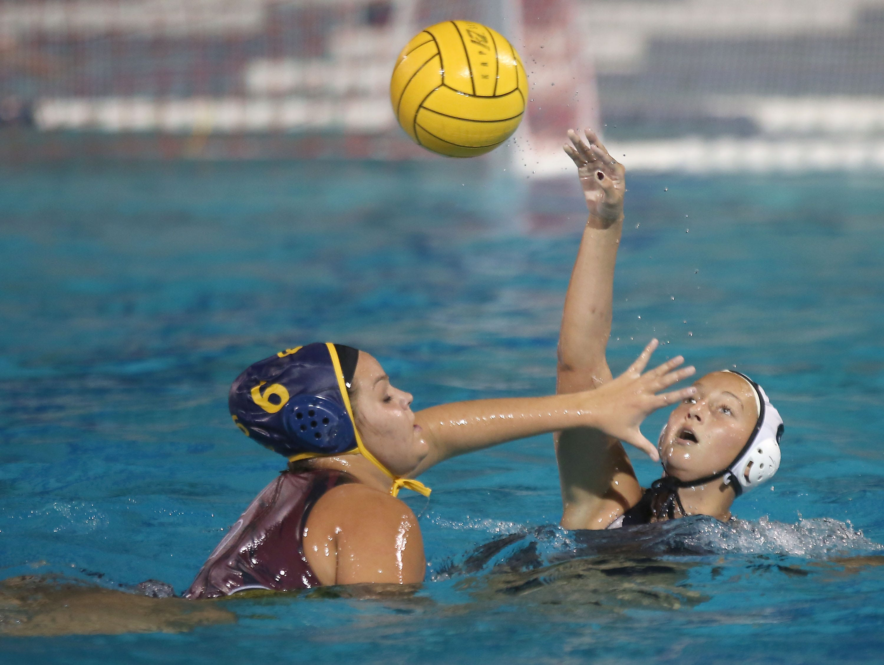 Kyndall Russell, right tries to get a pass off while La Quinta's Natalie Hampton, February 8, 2016.
