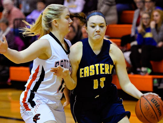 Eastern York's Brooke LaCesa, right, looks to get around