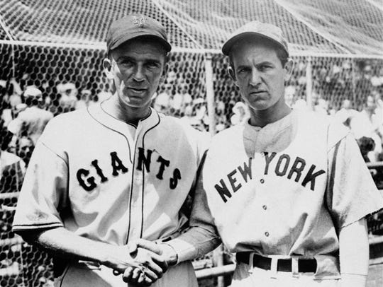 Carl Hubbell of the Giants, left, and Vernon Gomez
