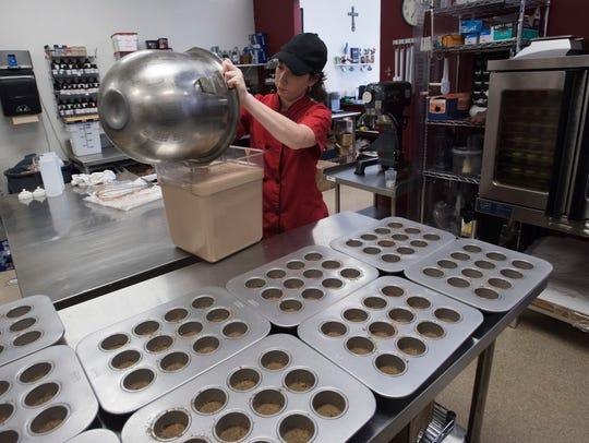 Kayla Parton fills cake molds with a signature Bushwacker