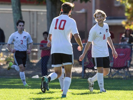 Jackson's Drew Greenblatt (8) is congratulated after scoring a goal. Pinelands vs Jackson Memorial Shore Conference Tournament soccer. 