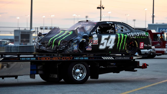 Kyle Busch's wrecked No. 54 Toyota is hauled away after Busch slammed into an interior wall with no SAFER barrier at Daytona International Speedway.
