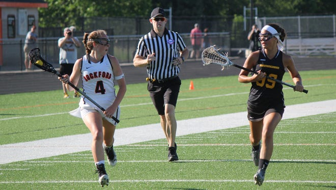 Brooklyn Neumen leads an offensive attack for Rockford, as Birmingham United's Chloe Mihalcheon attempts to keep pace.