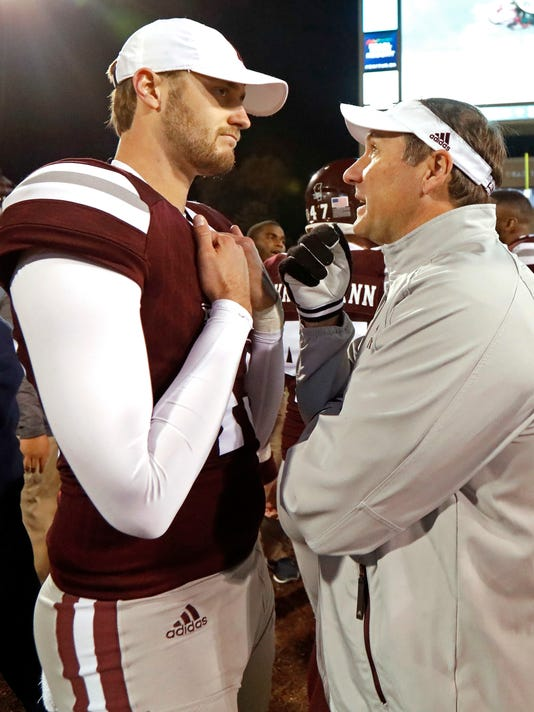 Mississippi State coach Dan Mullen speaks with punter Logan Cooke following the team's 31-28 loss to Mississippi in an NCAA college football game in Starkville, Miss., Thursday, Nov. 23, 2017. (AP Photo/Rogelio V. Solis)