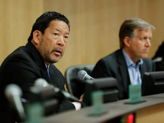 Seattle City Council president Bruce Harrell, left,