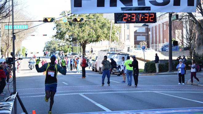 Kennedy Kemei, 37, is the first racer to finish the 2016 Tallahassee Marathon.