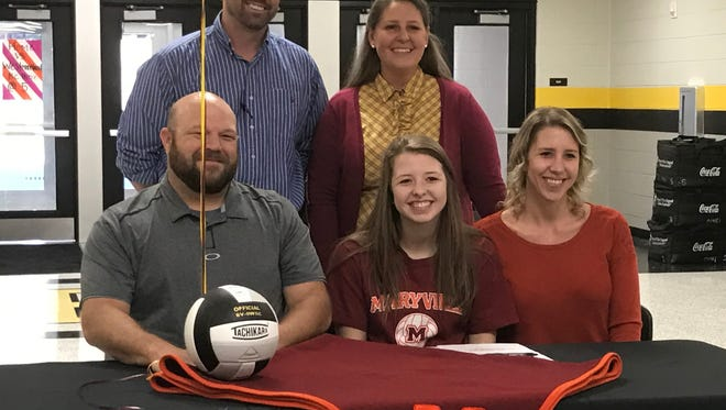 Hendersonville High senior Courtney Apedaile (seated, center) recently signed her letter of intent to continue her education and volleyball career at Maryville College.