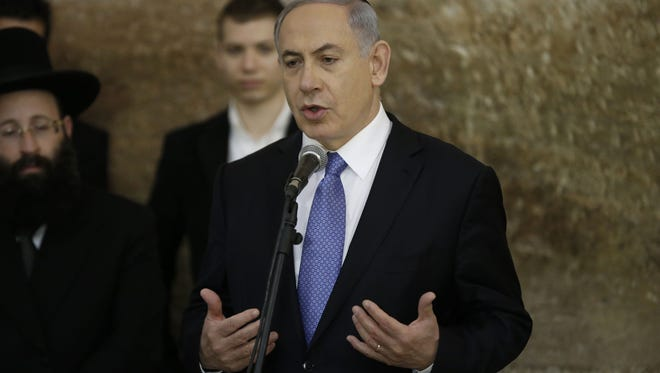 Israeli Prime Minister Benjamin Netanyahu speaks March 18 at the Wailing Wall in Jerusalem after his  Likud Party's victory in Israel's general election.