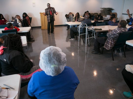 Bishop James Humbert speaks at Temple of Believers Deliverance Church, Indianapolis, Saturday, March 3, 2018. The church offers a no cost breakfast, aimed as an aid to community members who could use a hot meal, coupled with a short sermon at 11am on Saturday mornings.