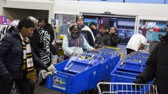Customers grab shopping carts to hunt for early Black