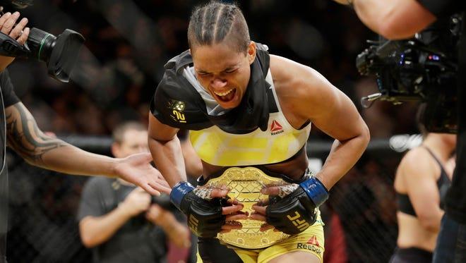 Amanda Nunes celebrates after defeating Miesha Tate at UFC 200 in Las Vegas.