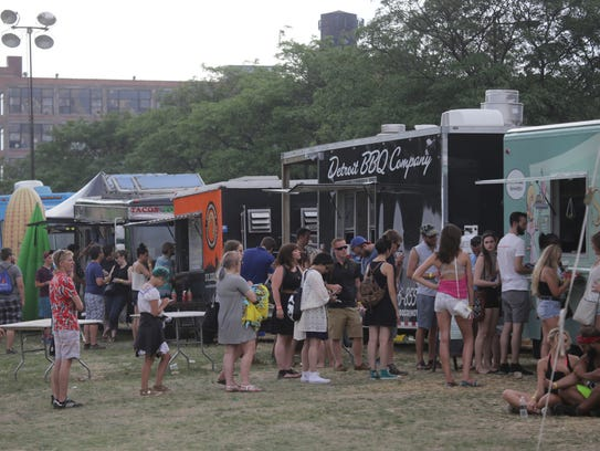People line up for food from the food truck vendors