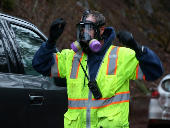 A technician wear a respirator as protection at the