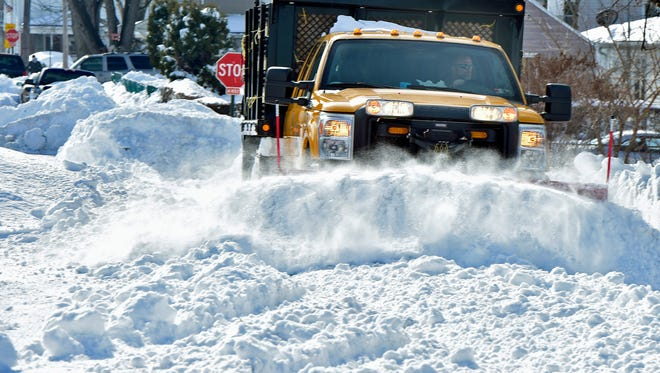 Guy Shaul, borough recreation department, runs a snowplow over a section of Third Street, Chambersburg, Monday,  Jan. 25, 2016. The region is still cleaning up after massive winter storm Jonas hit the area over the weekend.