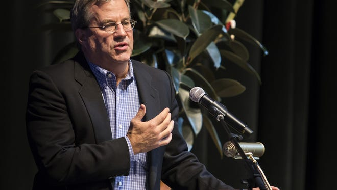 """Journalist and author of """"Dreamland,"""" Sam Quinones, discusses the heroin and opiate epidemic in America during a speech and discussion at the Cab Calloway School of the Arts in Wilmington on Thursday night."""