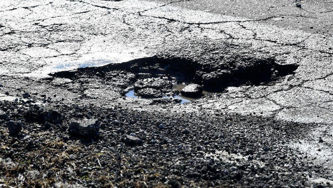 Potholes are forming on many streets in Jackson as above freezing temperatures melt ice and snow throughout the city.
