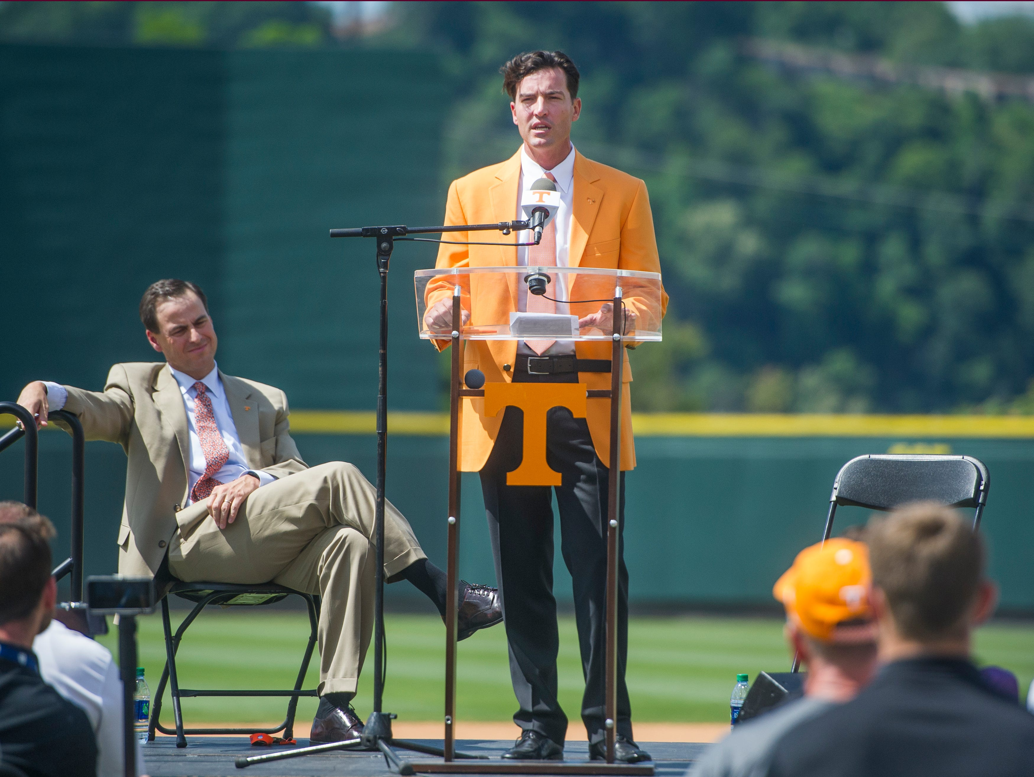 Tony Vitello, the new University of Tennessee baseball head coach, speaks at a press conference introducing him to the media, as John Currie, Tennessee vice chancellor and director of athletics, sits to his left at Lindsey Nelson Stadium on Friday June 9, 2017.