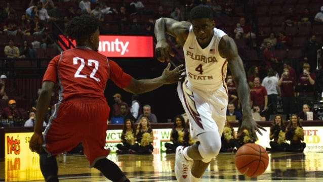 Dwayne Bacon dribbles by a Nicholls State defender during FSU's 109-62 victory. Bacon scored 21 points in the contest.