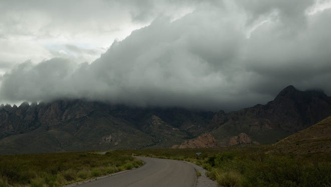 Clouds roll over the Organ Mountains, near the entrance to the Dripping Springs Natural Area, Wednesday, July 19, 2017. Large Thunderstorms dropped rain over Las Cruces and the surrounding area.